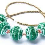 Bottle cap jewelry by Israeli designer Yoav Kotik