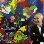 British artist Damien Hirst poses beside one of his works in Kiev
