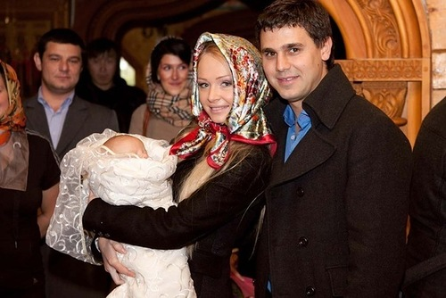 Dasha, Sergei and their son Artyom after having baptisized their son