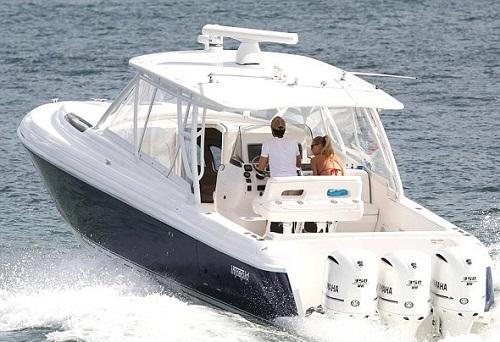 Enrigue drove the boat around Biscayne Bay, Miami