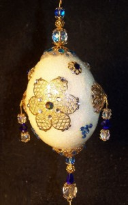 crafted in gold with enamel and Swarovski crystals over sterling silver