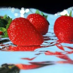 Strawberries. Hyperrealistic painting by Jason de Graaf, Canadian artist