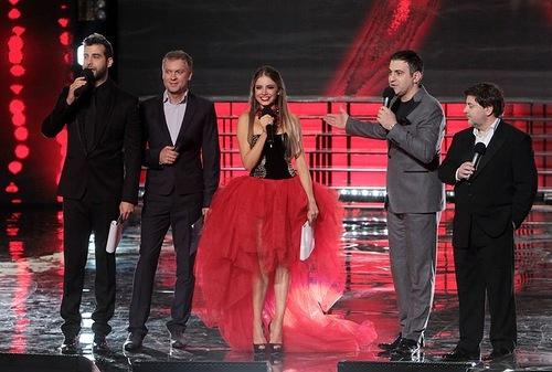 Russian comedians Ivan Urgant, Sergei Svetlakov and Garik Martirosyan next to Karina Zhironkina, Miss Ukraine 2012