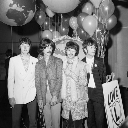 Together again to mark the release of their latest LP, the Beatles strike a familiar pose but in strange garb may 29th. (L to R) Paul McCartney, who shaved off his mustache last week; Ringo Starr in printed tie; John Lennon