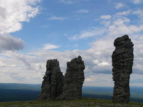 A helicopter landed next to Manpupuner rock formations. Pechora-Ilych Nature Reserve, Komi Republic, Russia