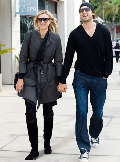 The pair, pictured shortly after their engagement in October 2010, ended things in the spring
