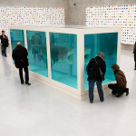 Visitors watch the work of British artist Damien Hirst at exhibition center Kunsthaus Bregenz in Bregenz, Austria