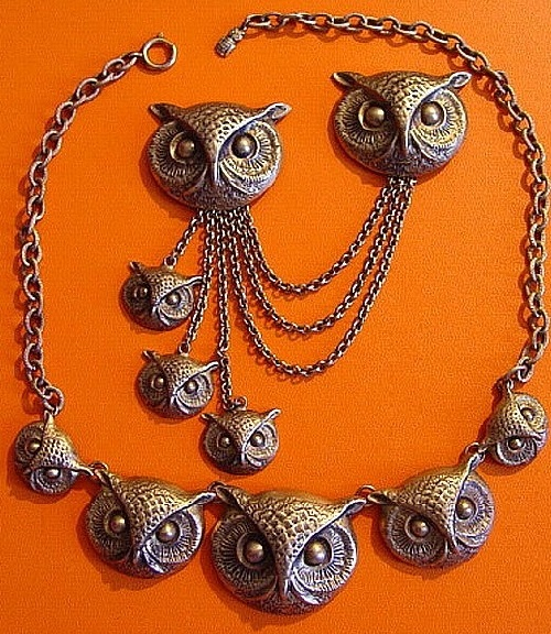 A set of owl inspired jewelry - necklace and brooch