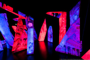 Ice stalagmites as sharp cliffs soar upwards. In the changing light on the faces runs a colorful kaleidoscope of images