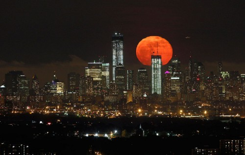 Weekend's supermoon May 5-2012. A full moon rises over the horizon of lower Manhattan in New York City. Photo taken from West Orange, New Jersey.