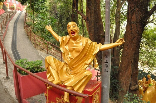 Painstakingly carved from dead jujube trees Buddha sculptures on display in Zhengzhou, China