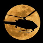 Helicopter on the supermoon background