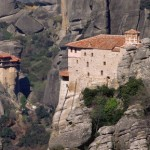 The monasteries of Agios Nikolaos Anapafsas (left) and Agia Roussanou (right) in Greece, which form part of the Meteora complex of precariously placed buildings