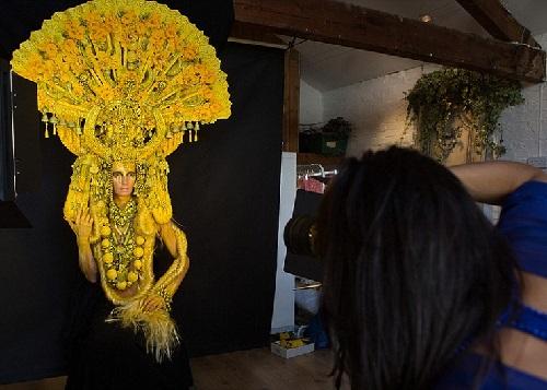 Model Marianna as the goddess Gaia, wearing a heavy handmade headdress