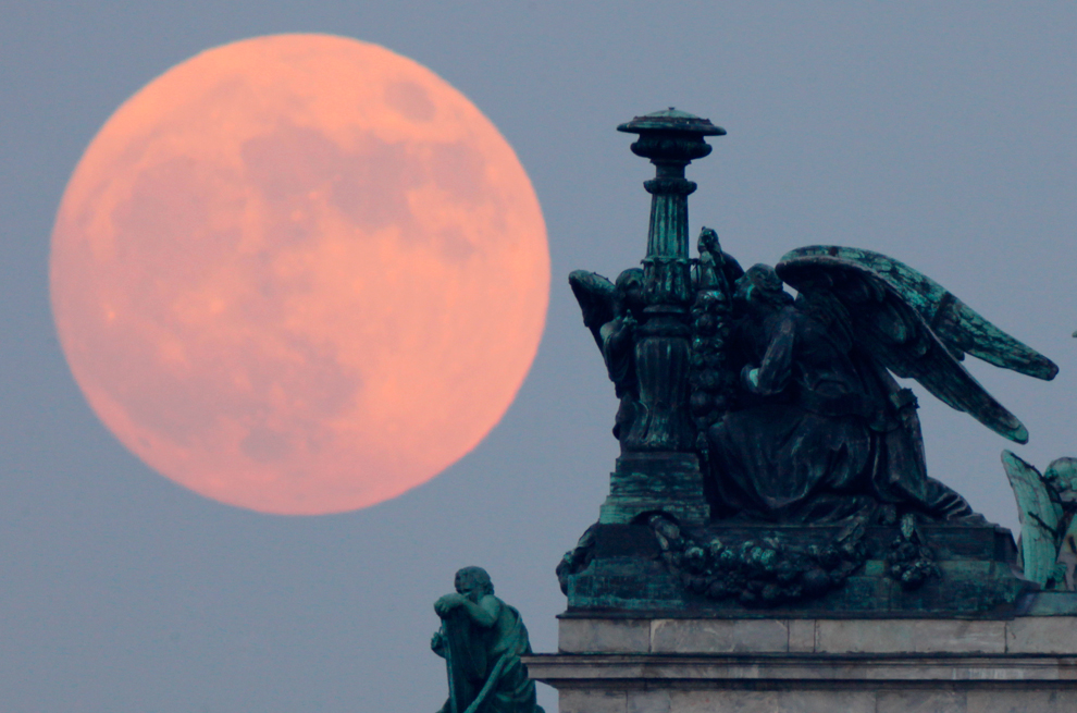 Moon behind statues of angels in St. Isaac's Cathedral in St. Petersburg, Russia.