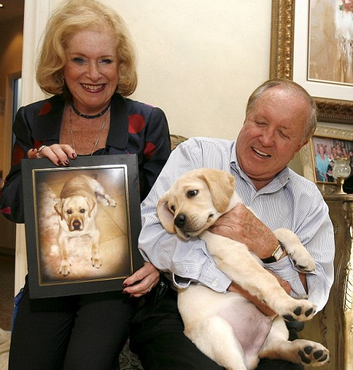 Sir Lancelot the first commercially cloned pet. Nina Otto holds a picture of Sir Lancelot while her husband Edgar cuddles Lancelot Encore as a puppy; the cloned dog has now fathered eight puppies