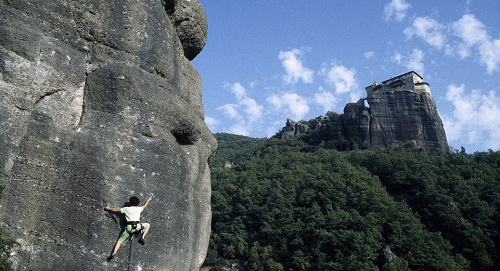 Head for heights: French mountain climber Catherine Destivelle during her ascension of the Rocher Saint Esprit, in the Meteora, with the Monastery of Roussanou located on a parallel summit