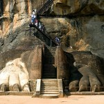 Visitors ascend the stairway to the ancient structure, which contains caves prepared by devotees of the Buddhist Sangha. Sigiriya (Lion Rock) Sri Lanka