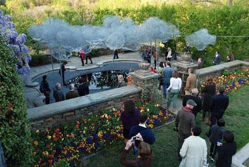 Visitors to the garden to enjoy the sparkling installation of Swarovski crystals