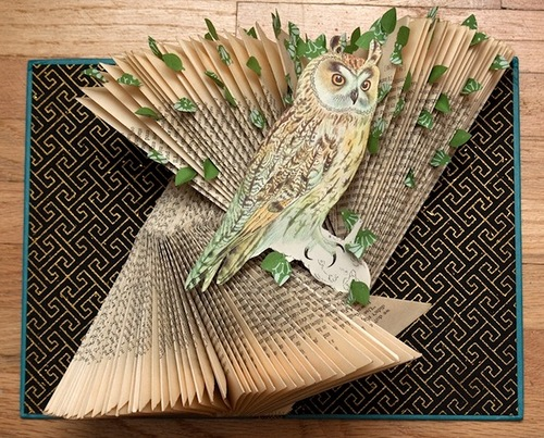 Book art installation with an owl. Work by Canadian artist Rachael Ashe