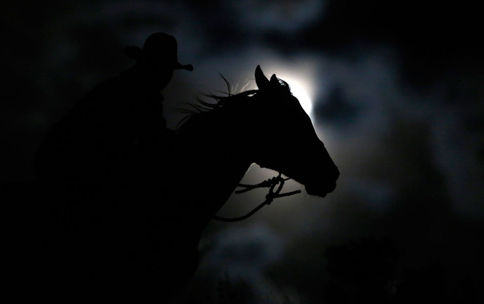 The rider on the background of the full moon in Three Forks, Montana