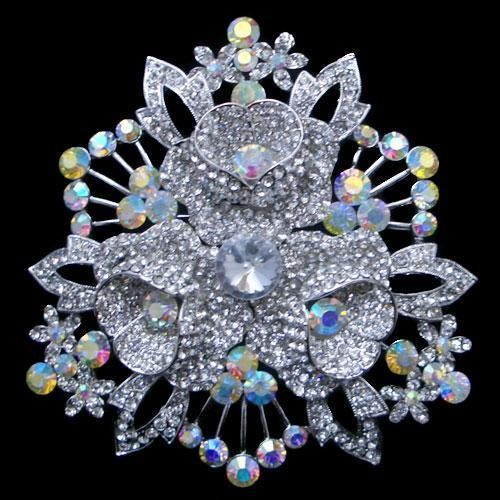 Fantasy of jewelry masters in beautiful brooches decorated with Swarovski crystals