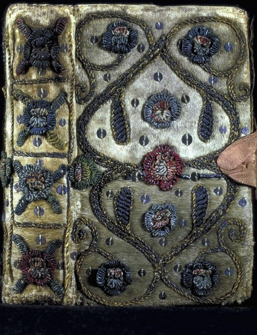 1632 edition of the Whole book of psalms is bound in white satin with a floral design of raised embroidery in metal thread of gold, silver and various other colors