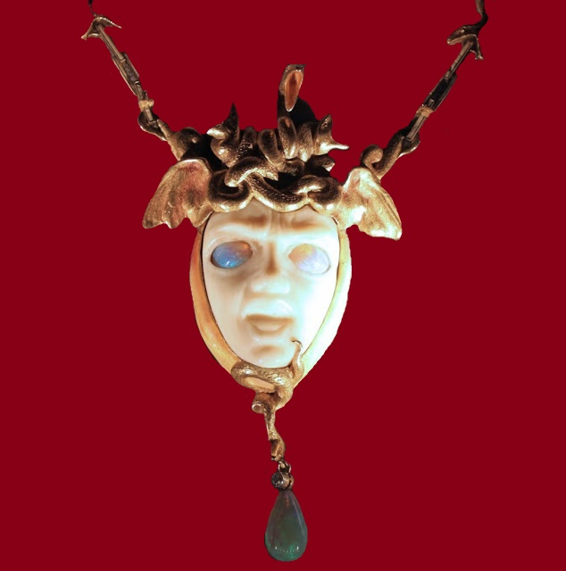 1898 pendant Medusa. Ivory carved face and opal eyes