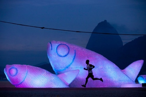 Installation of Fish sculptures made from discarded plastic bottles at Botafogo beach in Rio de Janeiro, Brazil