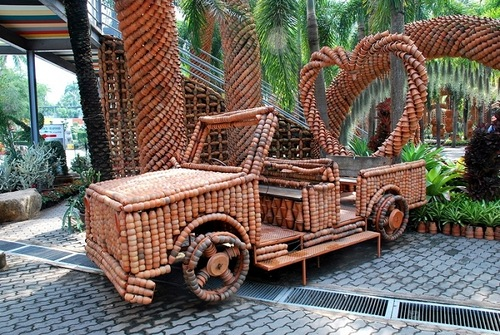 Automobile art installation. Garden of pots in Nong Nooch park, Thailand