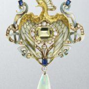 Heart shaped peacock brooch pendant. Enamel, peridot, diamond, and opal drop. Sold for $34,596 at Bonhams, London, in 2012