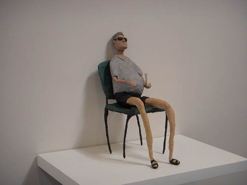 Sitting on a chair man. Modeling clay figurines by Revital Falke, sculptor from Israel