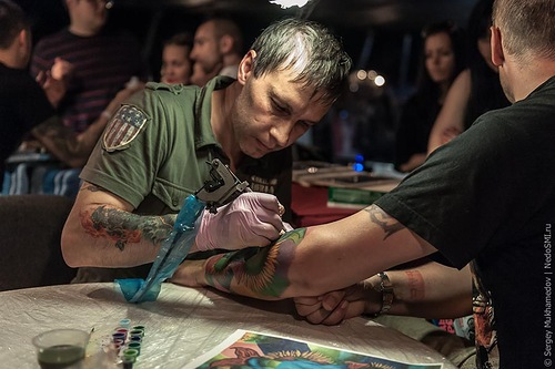 Tattoo master creating his work