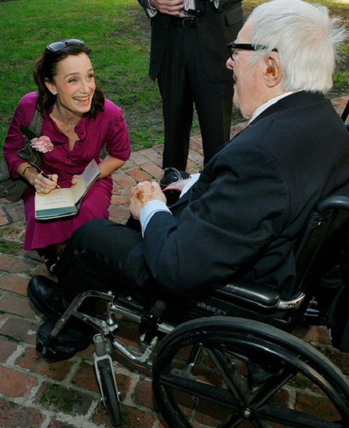In a wheel chair, Ray Bradbury
