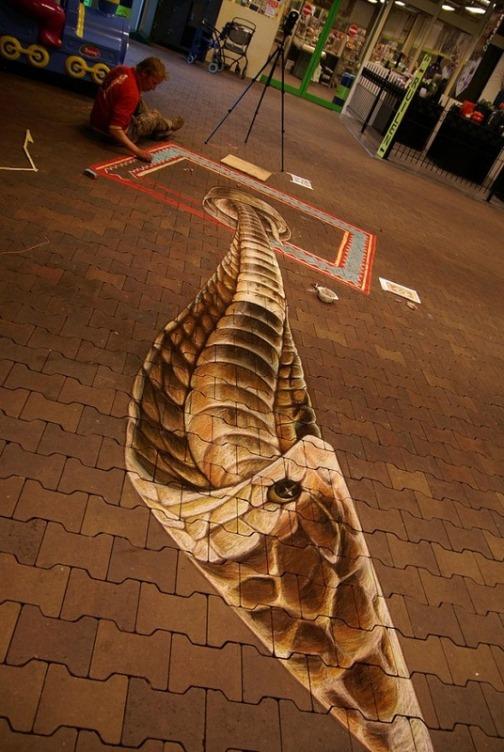 Detail of snake. Three-dimensional street art by Dutch artist Leon Keer