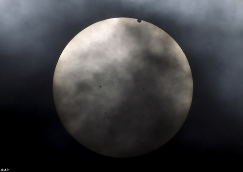 Venus begins to pass in front of the sun, as visible from New York, Tuesday, June 5, 2012
