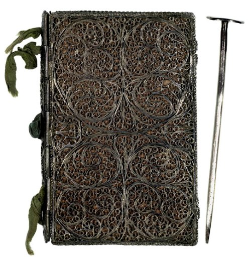 Writing tablet bound in finely worked silver filigree