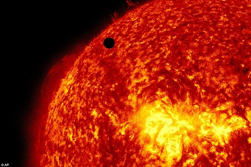 this image provided by NASA shows the Solar Dynamic Observatory's ultra-high definition view of Venus, black dot at top center, passing in front of the sun on Tuesday, June 5, 2012