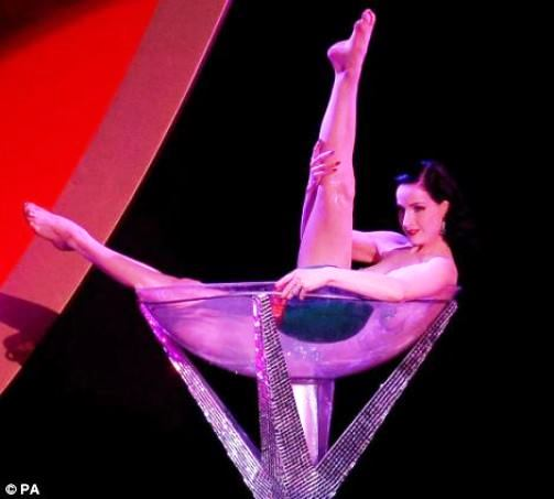 modern burlesque centres on exotic dancing. Normal-sized burlesque dancer Dita Von Teese performs her act in an over-sized martini glass at London's Olympia in 2006