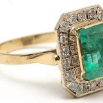 Gold ring with the natural Ural emeralds and diamonds