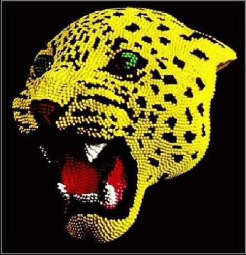 Snow leopard match head sculpture