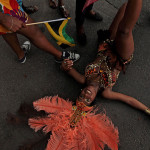 18-year-old Courtney Stewart of the group 'Soca Associates Band' fell to the pavement during the annual parade of Caribbean culture in Dorchester, Massachusetts, USA.