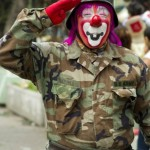 A clown in military clothes salutes as he takes part in the pilgrimage to the Virgin of Guadalupe's basilica, Mexico's patron saint, in Mexico City on July 18, 2012.