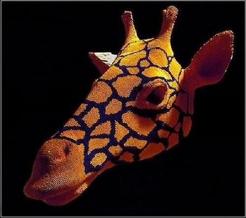 Giraffe match head sculpture