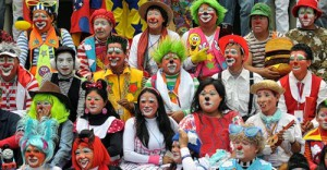 A group of clowns pose for the camera during a parade in the historic centre of Guatemala City in the framework of the IV Latin American Clown Congress on July 24, 2012.