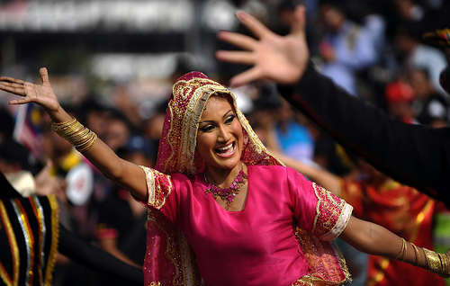 A woman dancing in a parade in honor of National Independence Day in Kuala Lumpur, Malaysia