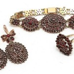 Czech silver set, consisting of a ring, bracelet and earrings. Silver gilt covered with a scattering of pomegranate