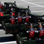 Turkish veterans holding flags during a parade in honor of the anniversary of Victory Day in Ankara, Turkey