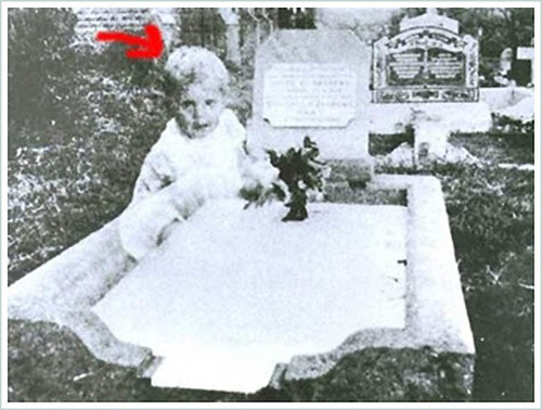 famous ghost photos. Ghost of a young child sitting next to the grave