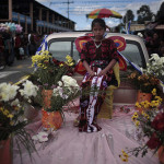 A girl sits in a decorated car during a parade in honor of the national Independence Day in Solola, Guatemala
